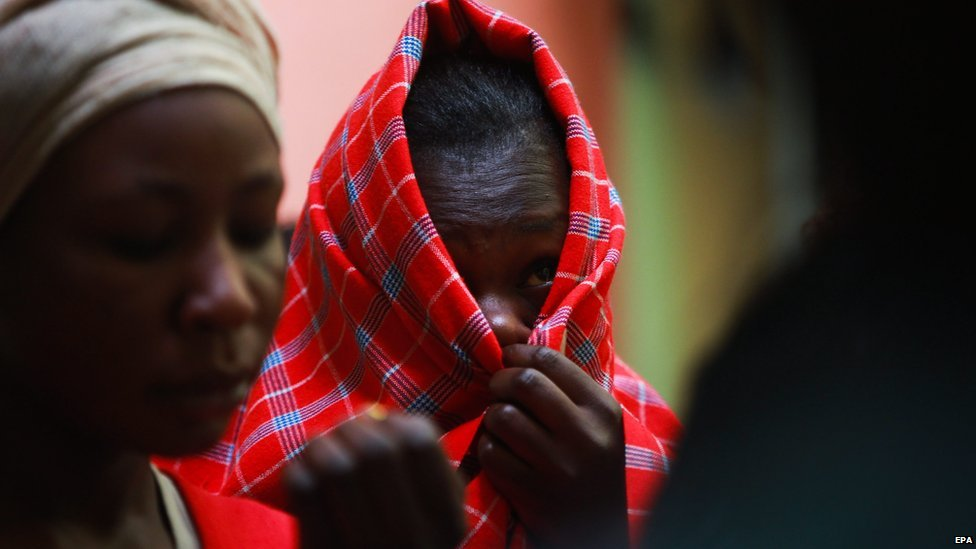 One of the Kenyan sex workers (C) covers her face during a protest outside the offices of Independent Policing Oversight Authority (IPOA) in Nairobi, Kenya 11 September 2014