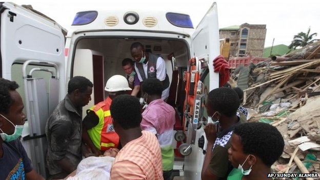 Rescue workers carry a survivor into an ambulance in Lagos, Nigeria, on 13 September 2014.