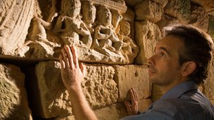 Dr Dan Penny finds medieval carvings under a stone bridge in the Cambodian jungle