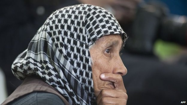 A woman listens to the sermon during the opening of the Open Mosque, on September 19, 2014 in Wynberg, Cape Town.