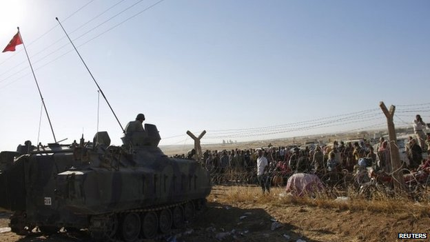 Turkish soldiers stand guard on the Turkish-Syrian border near Suruc, 22 September