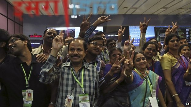 Indian Space Research Organization scientists and other officials cheer as they celebrate the success of Mars Orbiter Mission