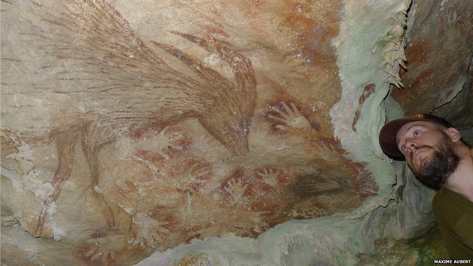 Maxime Aubert looking at cave art (from BBC News)