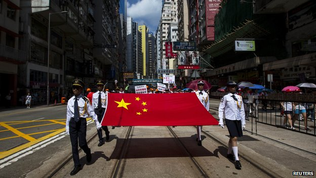 Pro-China youth group marches in Hong Kong in August