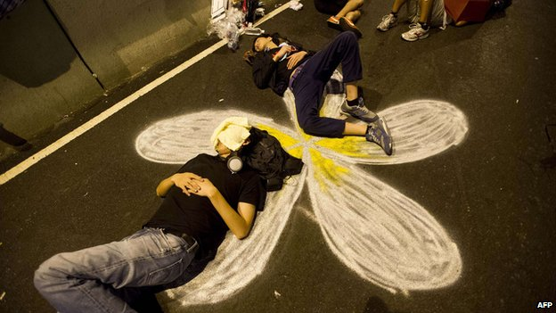 Pro-democracy demonstrators sleep during a protest in the Central district of Hong Kong on September 30, 2014
