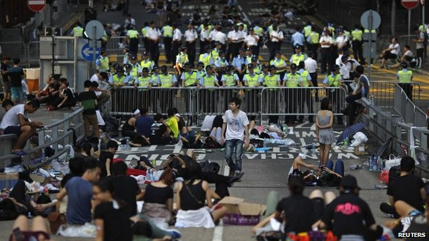 Protesters block a street near government headquarters in Hong Kong on 30 September 2014
