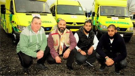 Alan Henning with convoy members and ambulance