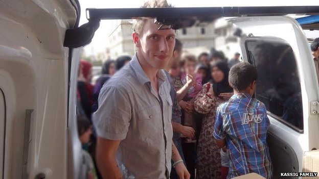 An undated photo provided by Kassig family shows Abdul-Rahman Kassig standing outside a truck of supplies for Syrian refugees.