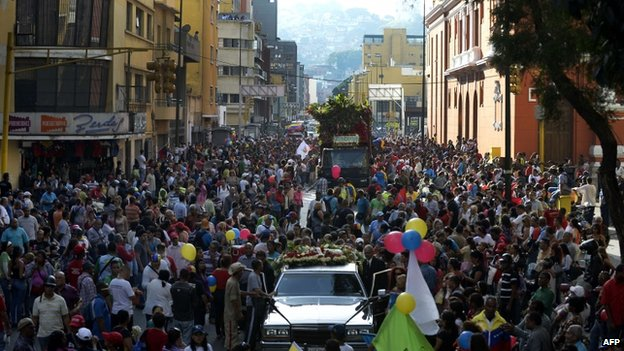 Thousands of people accompanied the coffins through the streets of Caracas, 4 Oct 14