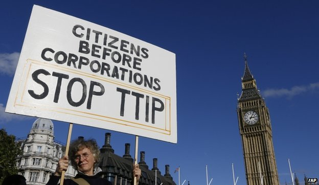 A demonstrator holds a banner in Parliament Square in London on 11 October 2014