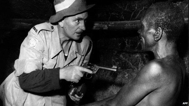 A night raid organised by the colonial army and police in Kenya to find members of the Mau Mau (1952)