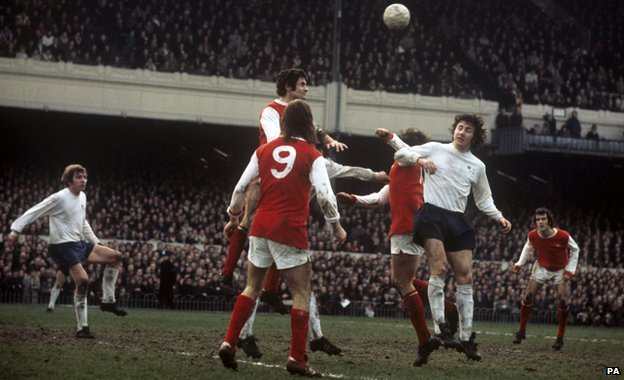Arsenal's Charlie George and Frank McLintock in a tussle with Roy McFarland of Derby in 1972
