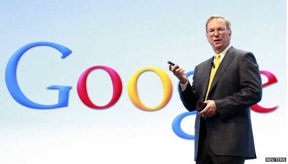 Eric Schmidt in front of Google logo
