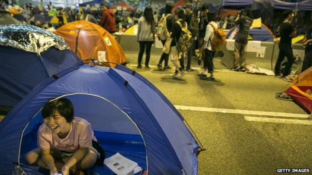 Protesters relax in tents at the main protest site as weeks of ongoing protests continue in Hong Kong on 19 October 2014