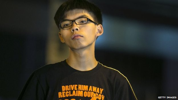 Student leader Joshua Wong speaks at a pro-democracy protest site outside the central government offices in Hong Kong, 19 October 2014