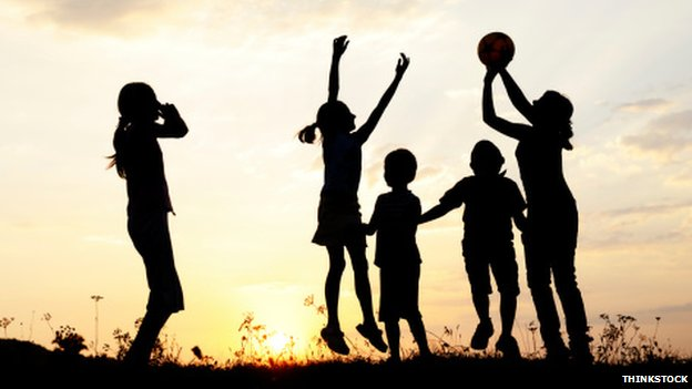 Children playing as the sun goes down