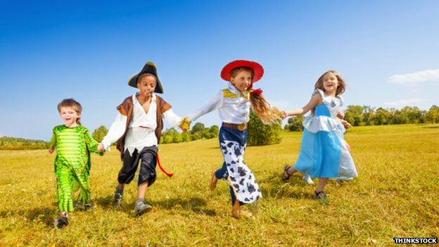 Young children running in a field
