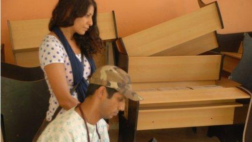 Filmmaker Nisha Pahuja (standing)