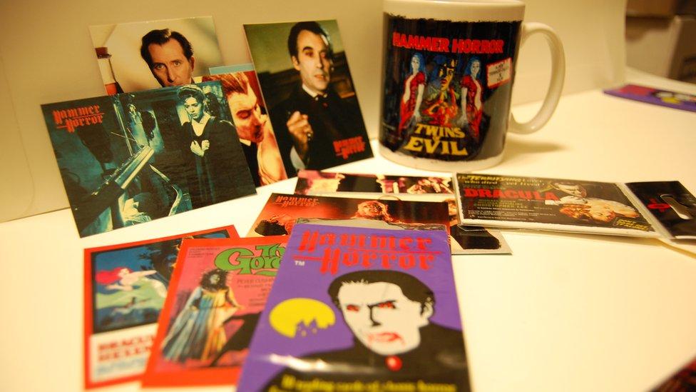 A mug and postcards