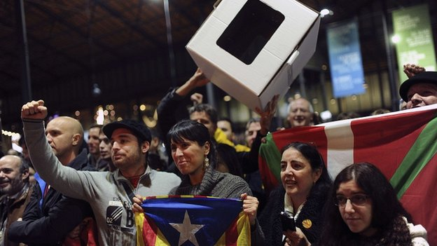 Catalan activists wave a cardboard ballot box at a rally in Barcelona. 9 Nov 2014