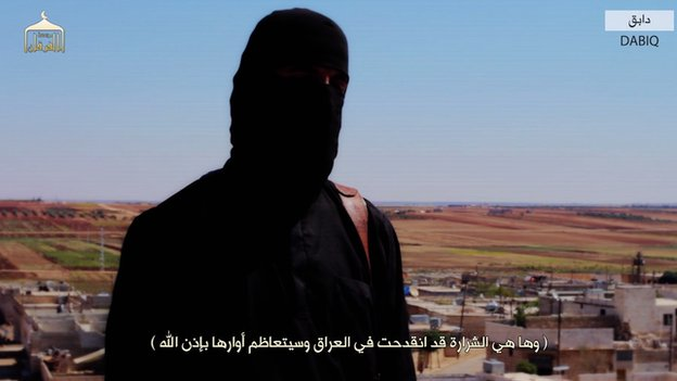 Islamic state militant appearing in a video in Dabiq, Syria
