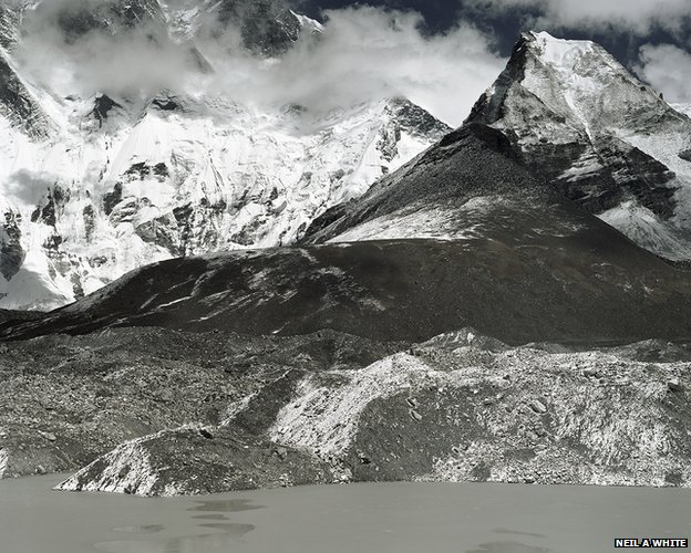 A small lake has formed close to the natural dam of Imja Tsho glacial lake