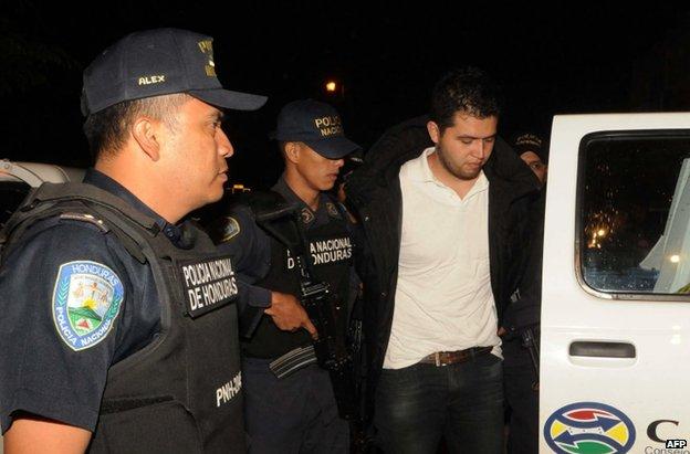 Aris Valentin Maldonado is escorted by police in Santa Barbara, Honduras, 18 November