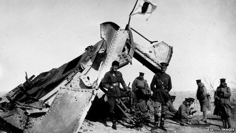 British and Japanese officers by a wrecked German gun after the siege of Tsingtao