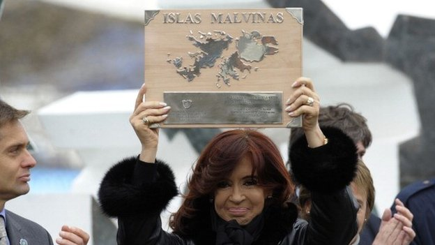 Argentine President Cristina Fernandez de Kirchner holds a plaque before delivering a speech during a ceremony to mark the 30th Anniversary of the 1982 South Atlantic war between Argentina and the Britain over the Falkland Islands