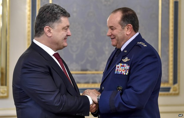 Ukrainian President Petro Poroshenko, left, greets U.S. European Command Commander, NATO Supreme Allied Commander Gen. Philip M. Breedlove in Kiev, Ukraine, Wednesday 26 November 2014