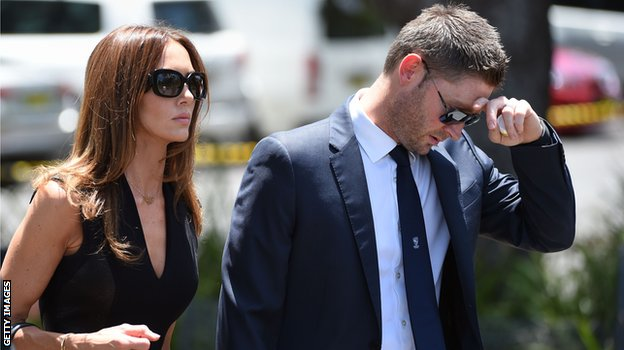 Australia captain Michael Clarke and wife Kyly arrive for the service