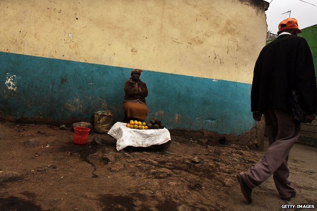 "A woman selling goods in Eastleigh/ ""Little Mogadishu"""