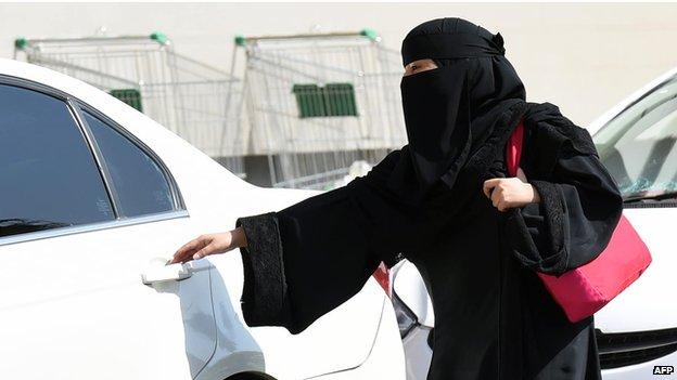 Saudi woman entering car