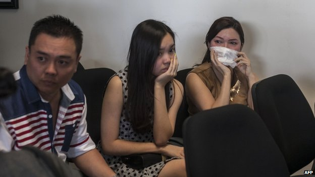 Anxious family members wait for news at the airport in Surabaya