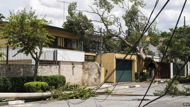 General view of a house hit by fallen trees and lamp posts close to Ibirapuera park due to an electric storm registered in Sao Paulo, Brazil, 29 December 2014