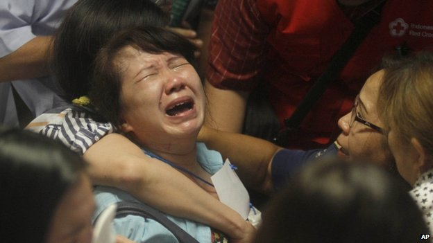Relatives at Surabaya airport react to the sighting of bodies - 30 December