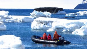 People in a dinghy in Antarctica