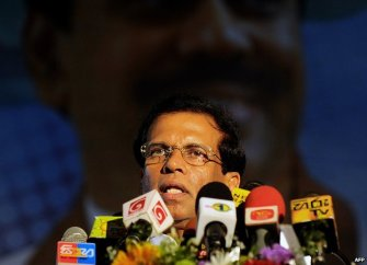 Sri Lanka's Health Minister Maithripala Sirisena addresses health workers in Colombo on November 21, 2014, at a meeting marking the recruitment of new employees