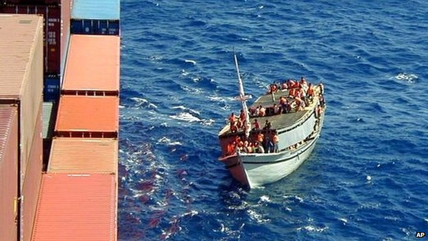 A boat carrying asylum seekers, trying to reach Australia, comes alongside a Norwegian ship in 2001