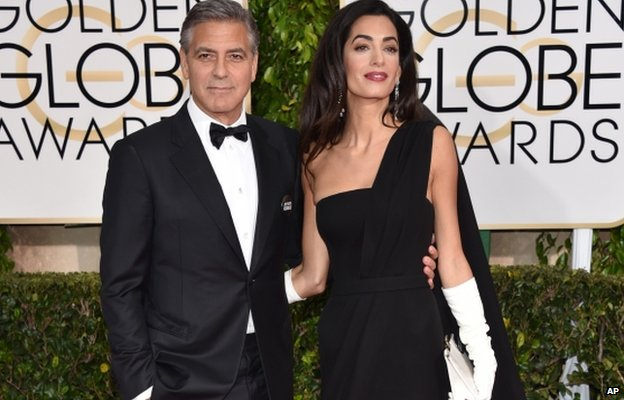 George Clooney, left, and Amal Clooney arrive at the 72nd annual Golden Globe Awards