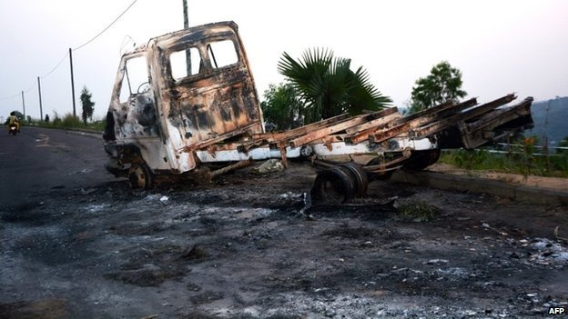 A picture shows a burnt truck on the road leading the University of Kinshasa, where demonstrations on 19 January 2015 in Kinshasa, to protest against moves to allow Democratic Republic of Congo's president to extend his hold on power.