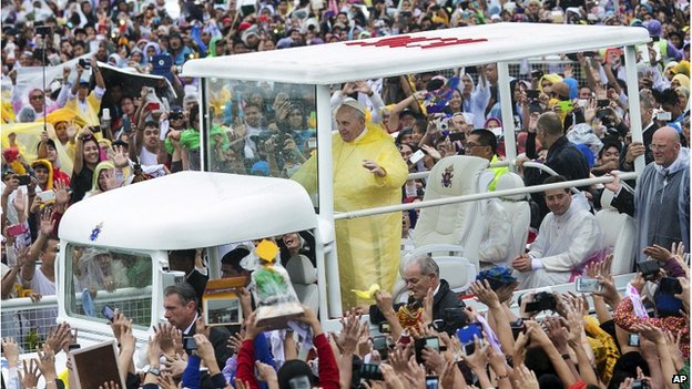 Pope Francis waves to the crowd as he arrives at Quirino Grandstand to celebrate his final Papal Mass in Manila, Philippines, Sunday, 18 January 2015
