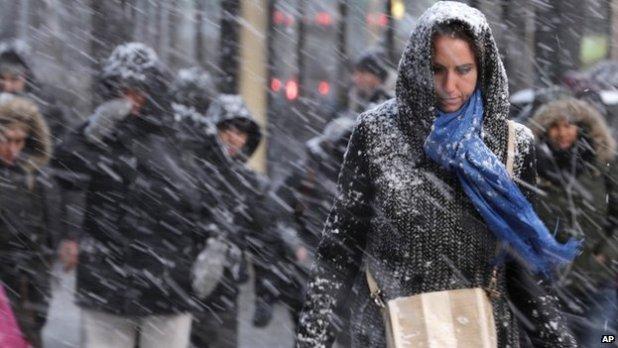Pedestrians make their way through snow in New York