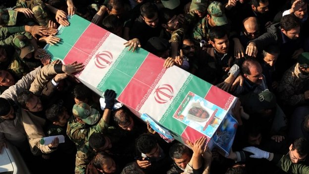 Iranians carry the coffin of Revolutionary Guards Gen Mohammad Ali Allah-Dadi, who was killed in an Israeli air strike in the Syrian Golan Heights on 18 January 2014
