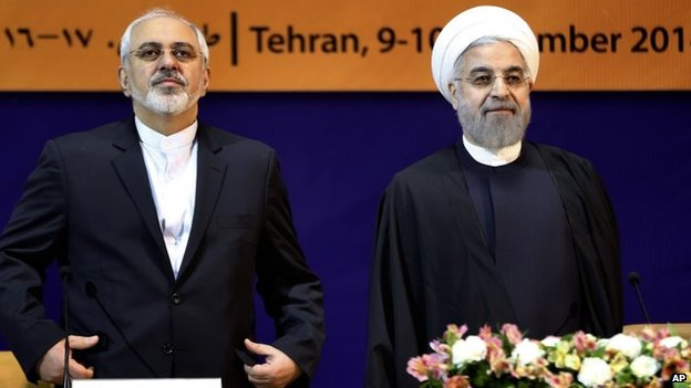 Iranian Foreign Minister Mohammad Javad Zarif and President Hassan Rouhani in Tehran (9 December 2014)