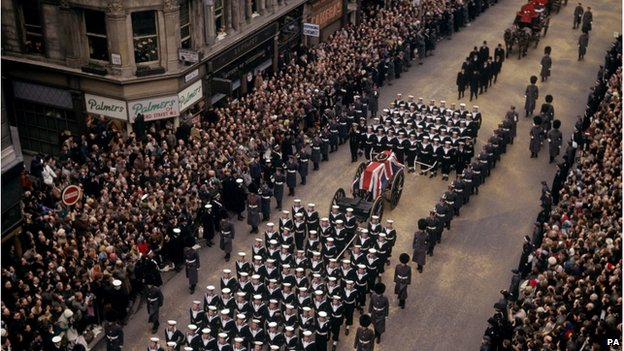 Crowds lining a London street as the coffin of Sir Winston Churchill passes along