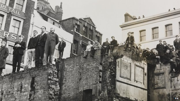 People standing on roofs to see Churchill's funeral