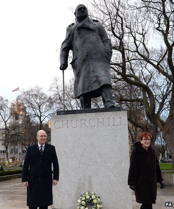 Randolph Churchill and Celia Sandys, the great-grandson and granddaughter of former Prime Minister Sir Winston Churchill, lay a wreath at his statue on Parliament Square
