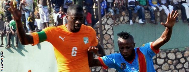 Ivory Coast's Yaya Toure battles with DR Congo's Jean Kasusula