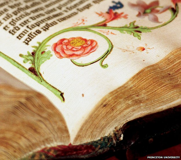 Vivid reds, pinks and greens of the illustrations run alongside the text in the Gutenberg Bible, the first printed Bible, which was produced in Mainz, Germany, in 1455.